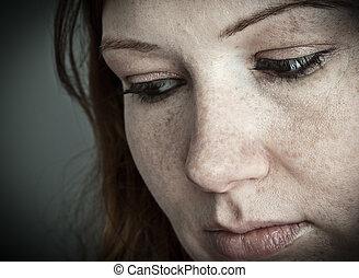 Sadness - Close of a young woman's face, sad expression