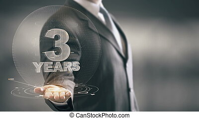Three 3 Year Businessman Holding in Hand New technologies