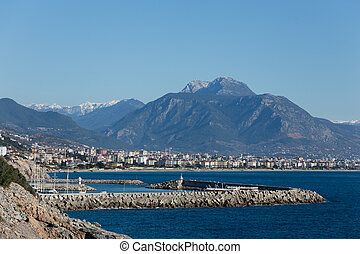 View of Alanya with marina in sharp focus and city and mountains