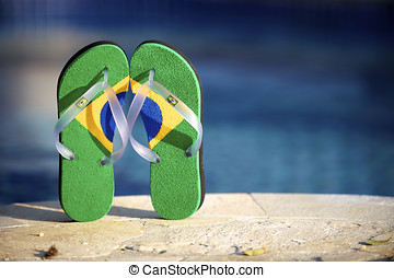 Brazilian flipflop in front of the swimming pool in Brazil