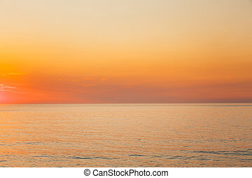 Calm Sea Or Ocean And Yellow Clear Sunset Or Sunrise Sky Background