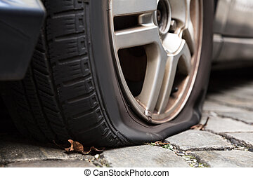 Damaged Flat Tire Of A Car