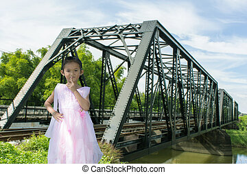 Asian children girl old iron railway construction bridge in Lamphun Thailand