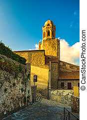 Castiglione della Pescaia, old street and church at sunset....