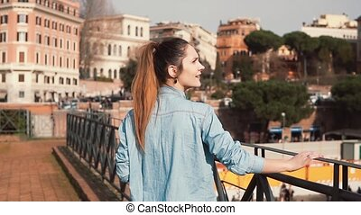 Woman tourist walks down the street in Rome, Italy....