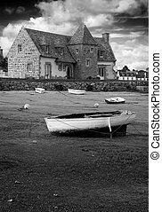 Ancient house and boats on a mooring - beautiful scenery in...