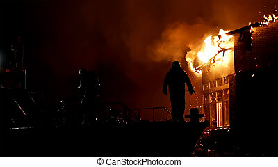 House on fire. Conflagration. Fireman fights fire. - House...