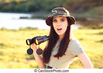 Surprised Explorer Girl with Camouflage Hat and Binoculars -...