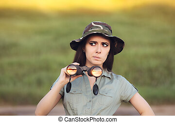 Circumspect Explorer Girl with Camouflage Hat and Binoculars...