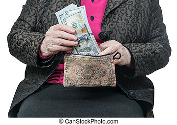 Hands of an old woman holding purse