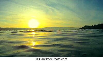 Sun hides behind the lake