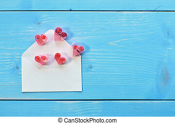 Envelope and few hearts put on it