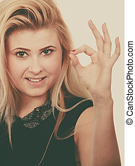 Blonde woman showing a ok gesture - Gestures and human...