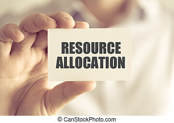 Businessman holding RESOURCE ALLOCATION message card -...