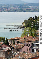 View of colorful old building in Sirmione and Lake Garda...
