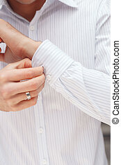 Close up of a hand businessman how wears white shirt and...