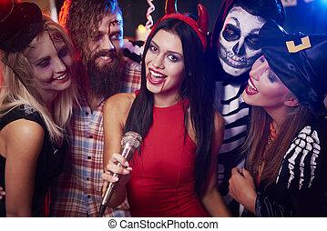 Singing karaoke at halloween party