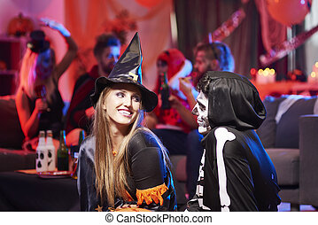 Flirty situation between witch and skeleton