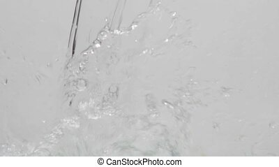 Flowing water on white background in slow motion