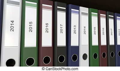 Line of multicolor office binders with 2013 - 2017 year...