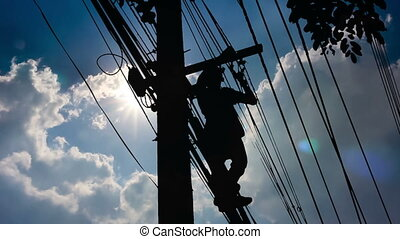 Silhouette Electrician wiring Newly on Pole