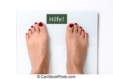 Woman feet on weight scales - Close-up of incognito woman...