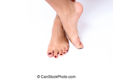Beauty concept of red painted toenails after a spa treatment...