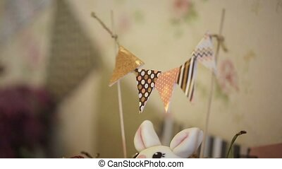 Triangle flags birthday decoration on celebration cake