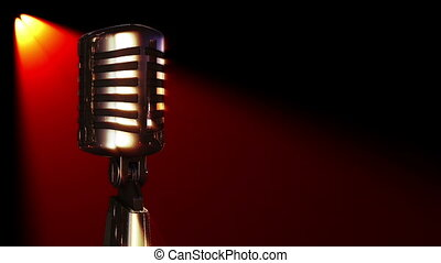 classic vocal microphone rotating in stage lights