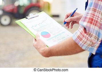 Farmer checking recent income data