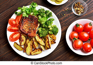 Grilled meat with vegetables on plate