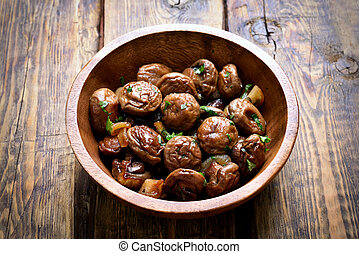 Fried mushrooms with onion in bowl