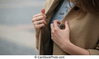 Young caucasian woman in jacket on a street