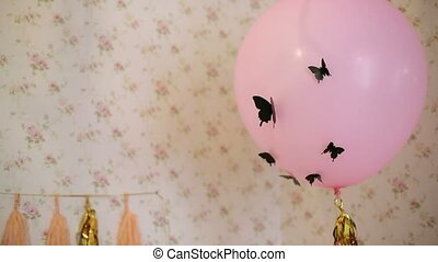 Pink balloon with black butterflies on a birthday party