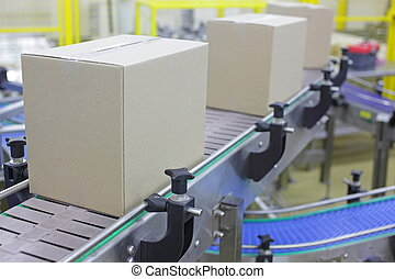 Automation - cardboard boxes on conveyor belt in factory