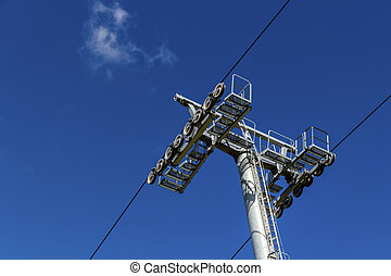 chairlift and blue sky, a symbol of transportation, ski,