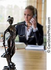 businesswoman in office - businesswoman sitting in an...