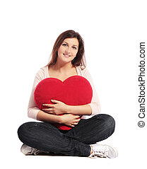 Valentine - Attractive young woman holding a heart-shaped...