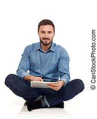 Cheerful man with digital tablet