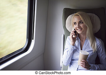 Smiling blonde businesswoman talking by mobilephone
