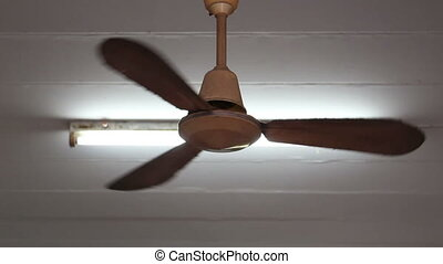A ceiling fan in a house