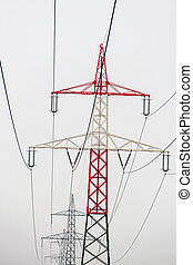power poles - poles of a high voltage line for power. power...