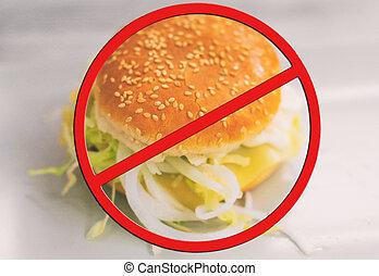 Junk food concept. Hamburger with salad.