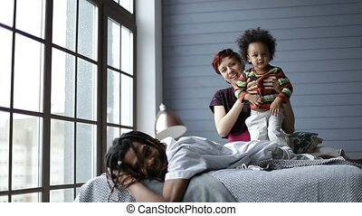 Happy interracial family spending leisure at home - Happy...
