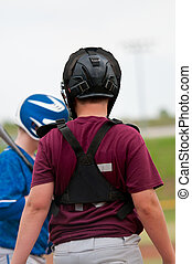 Youth baseball catcher - Young baseball boy catching behind...