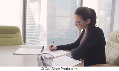 girl business lady in the office in a skyscraper 1