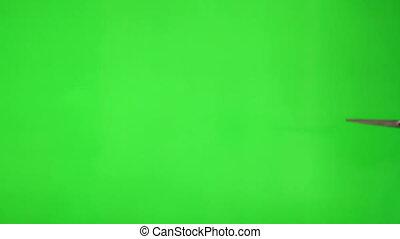 Cutting the green screen - Shot of Cutting the green screen