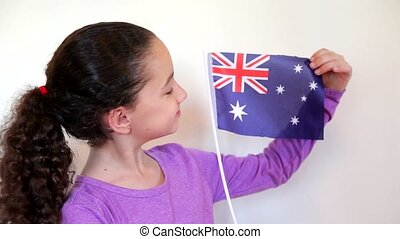 Cute girl holding flag of Australia - Shot of Cute girl...