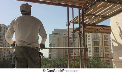 Construction worker at height with no helmet