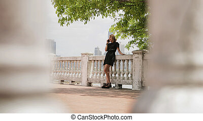 Colombian Girl In Panama City Talking On Mobile Phone -...